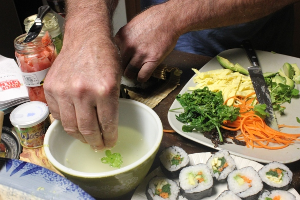moistening fingers so rice doesn't stick to them