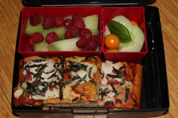 Fresh fruit, tomatoes and cucumber, pizza with whole wheat crust.